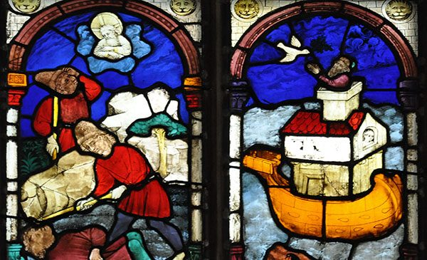 Stained glass window depicting two biblical scenes - Cain and Abel, and Noah and the Ark. Public domain image from Wikimedia Commons.